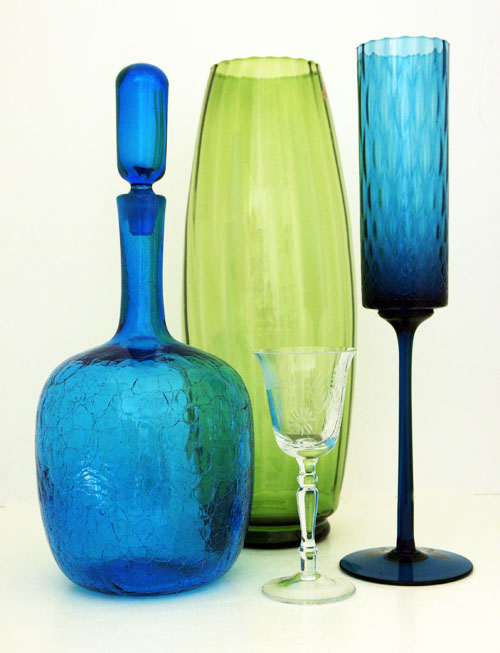 Mid century modern glass bullet vase made in 1960's Italy. Shown with other mid 20th century art glass items to help show color and size.