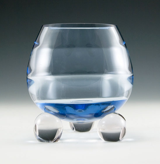 Tiffin Copen Blue Swedish Modern rose bowl with horizontal optics and three ball feet. Circa late 1940s to early 1950's. Thick handmade crystal.